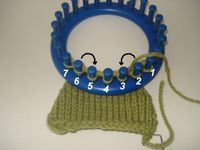 Decreasing on a knitting loom requires the manipulation of stitches from cert...