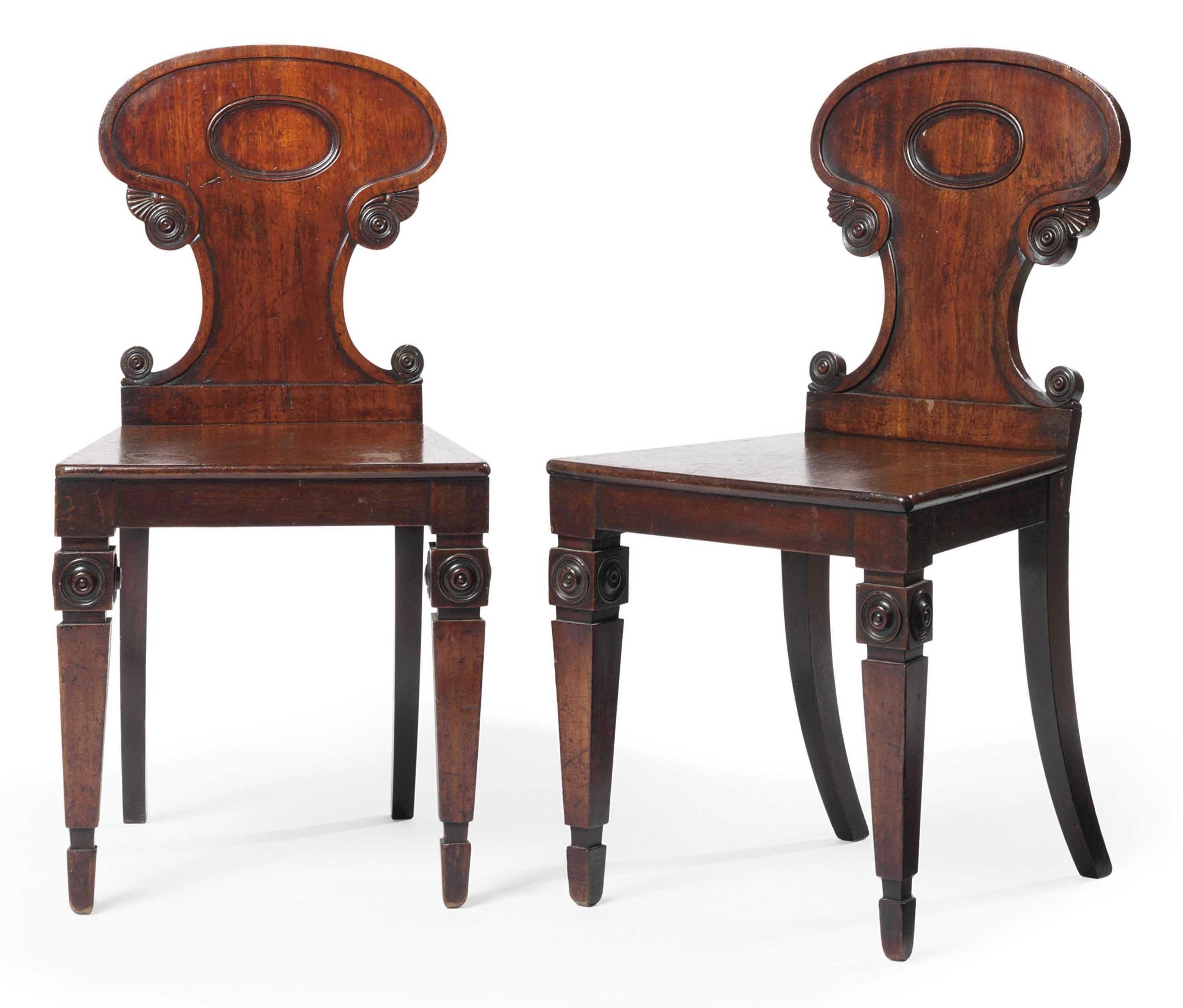 A pair of irish william iv mahogany hall chairs circa