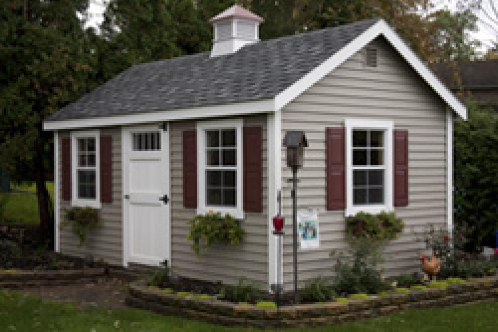 Cape Cod Barn 10 X 16 With Sandstone Vinyl Siding Tan House House Exterior Red Shutters
