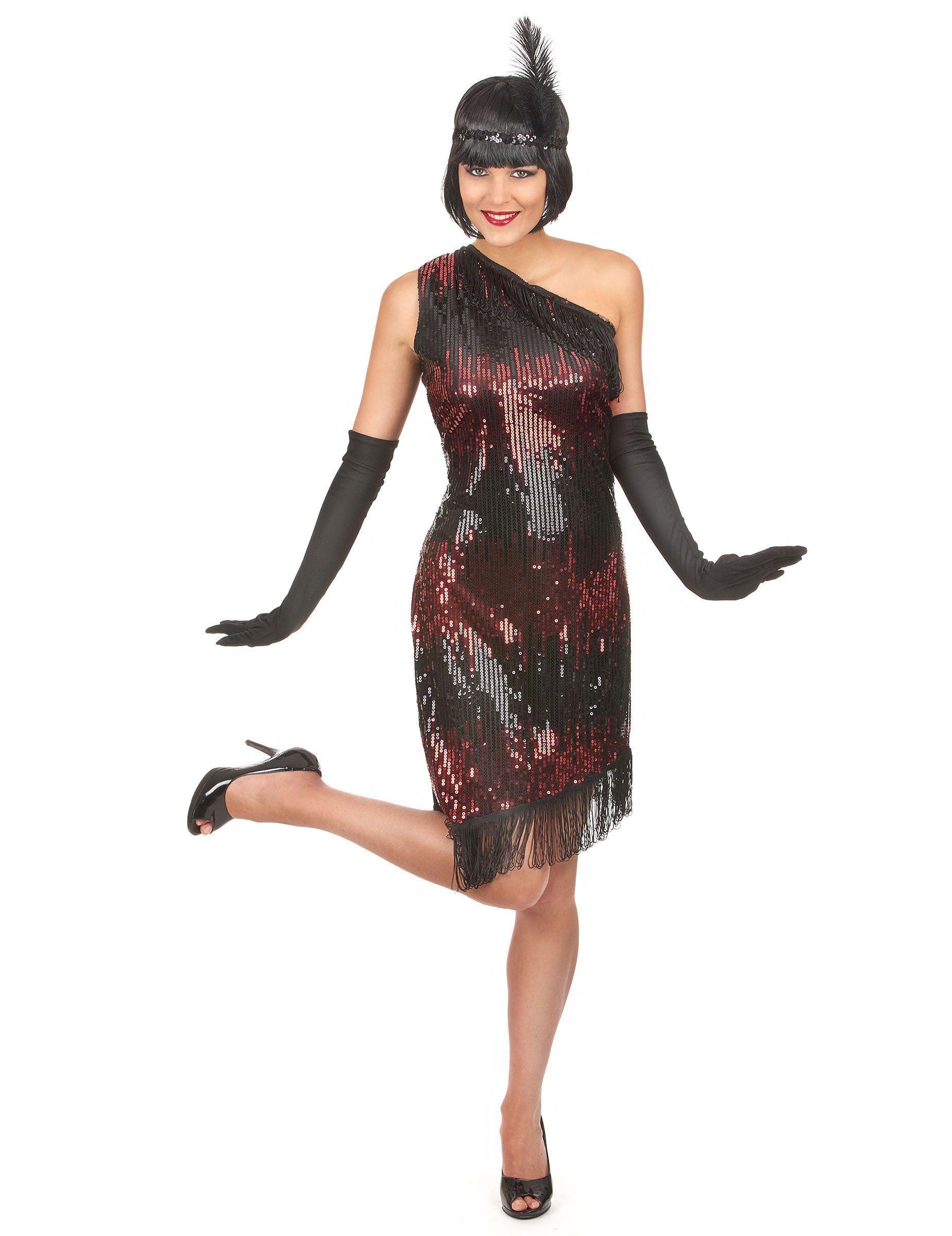 bb5e35436269c Disfraz de charlestón negro y rojo  Este disfraz de charlestón para mujer  está compuesto por un vestido negro