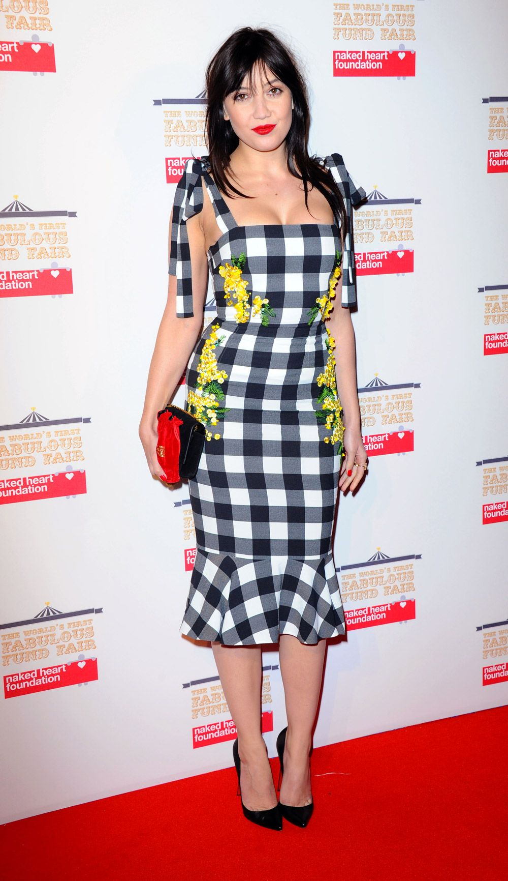 Daisy Lowe wearing Dolce&Gabbana to attend The World's First Fabulous Fund Fair in aid of The Naked Heart Foundation in London on February 24, 2015.