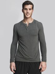The Neighborhood Henley in slate. We were inspired by the lights and buzz of city life for our upscale henley tops. With its body-skimming fluidity, extreme softness and performance-enhancing benefits, our newest Viloft® shirt is designed to make your life better amidst the hustle of metropolitan living. Shop this and other styles at www.coryvines.com