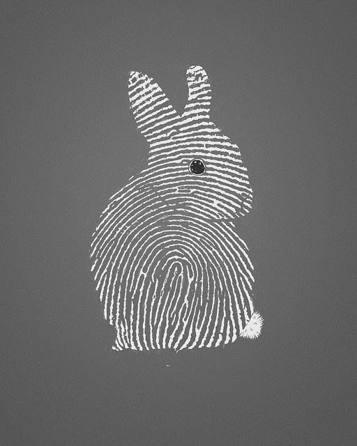 enlarge fingerprint and cut out shape.....embellish where needed and put on plain colored paper.....frame....