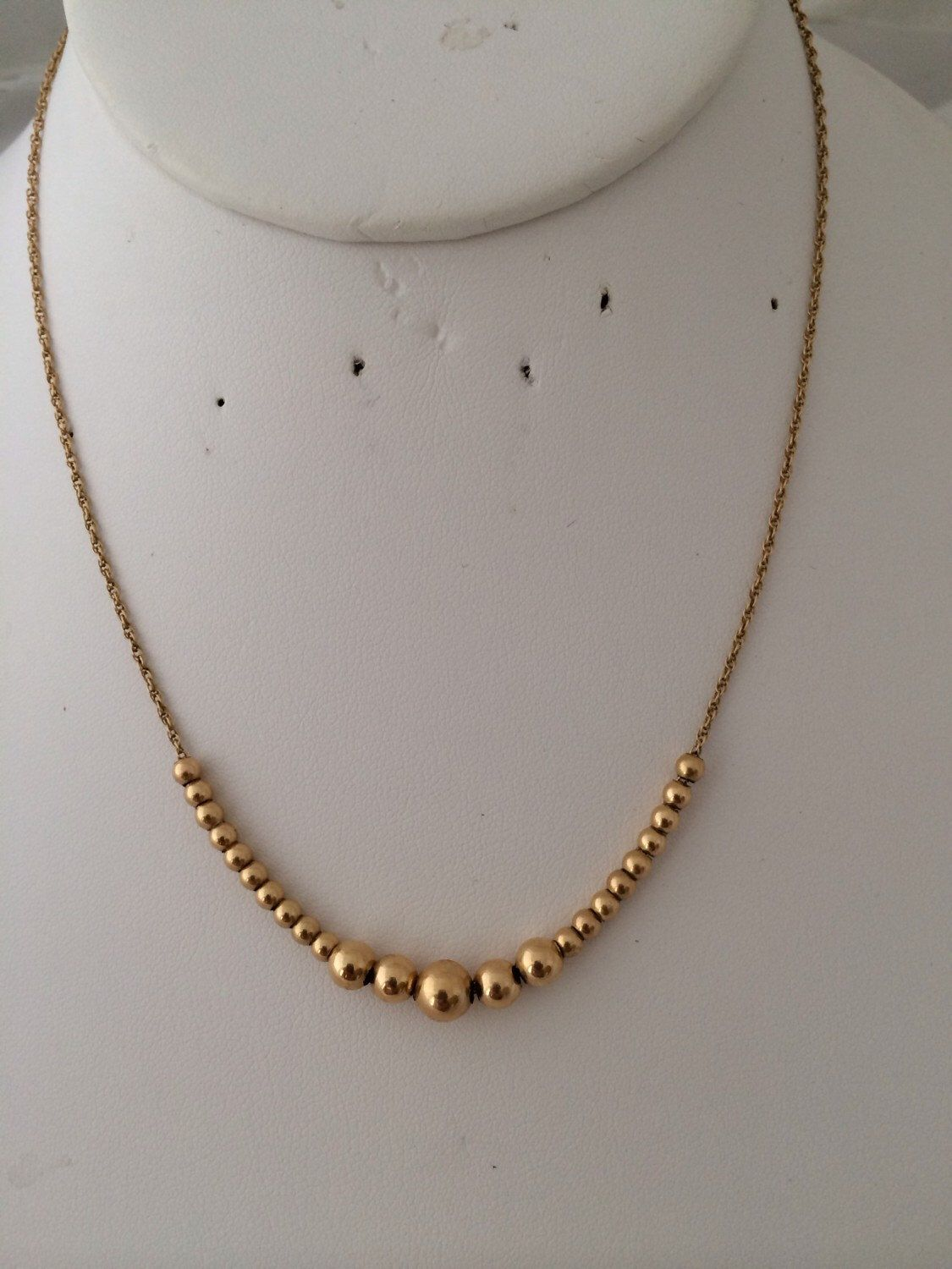 A personal favorite from my Etsy shop https://www.etsy.com/listing/237222174/lovely-14k-gold-floating-ball-add-a-bead. HauteCoutureLaLa