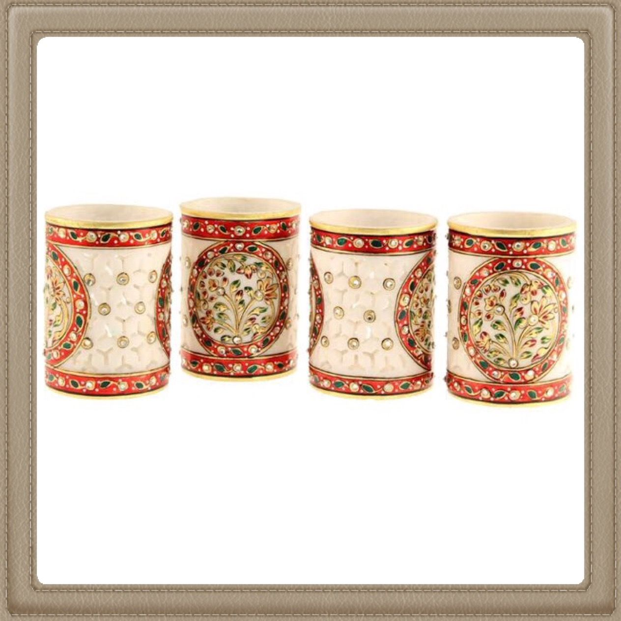 Marble handicraft pen holder. Its a different style of desk organizer. Also can be used to display your cutleries. Great way to draw attention to the table with its enchanting rajasthani work on marble.