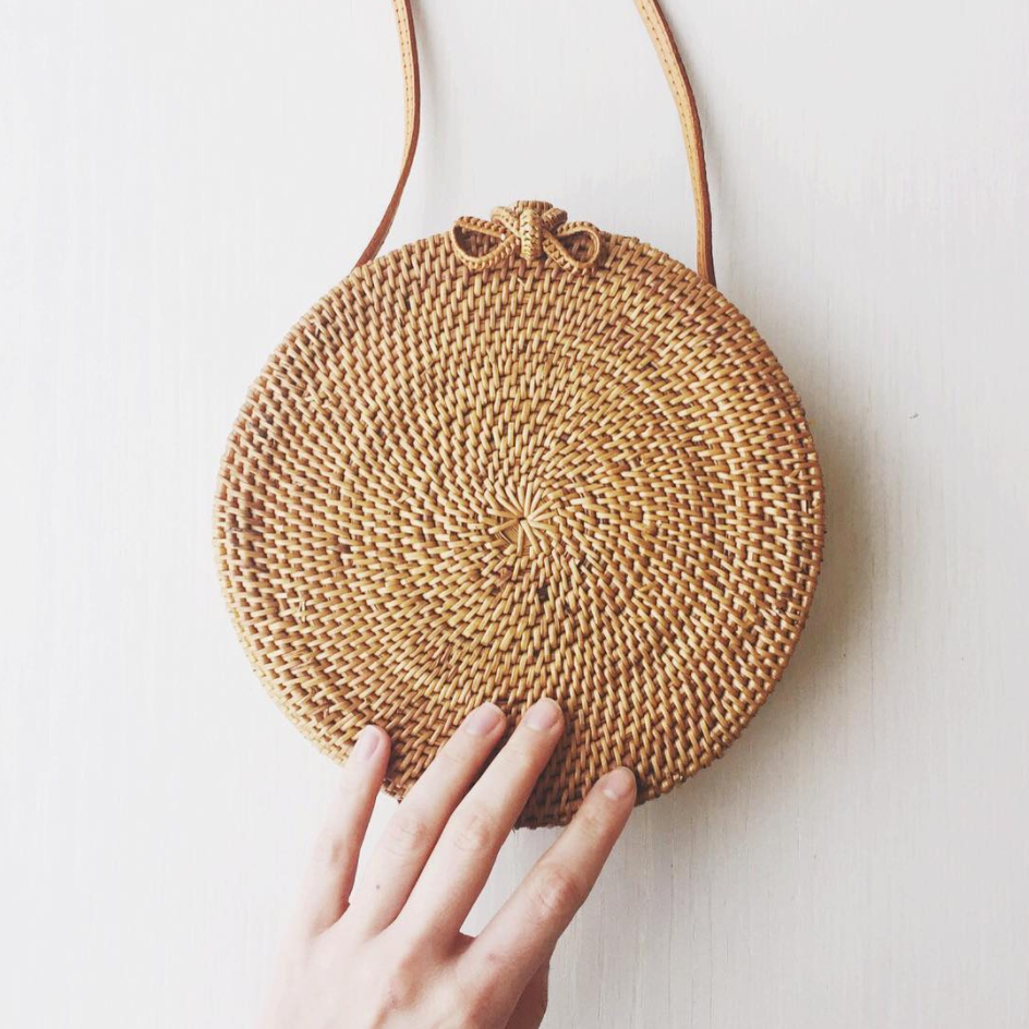 """PRE-ORDER. Bags will ship by July 7th.      * 100% handwoven rattan     * Leather strap     * 8"""" x 3"""""""