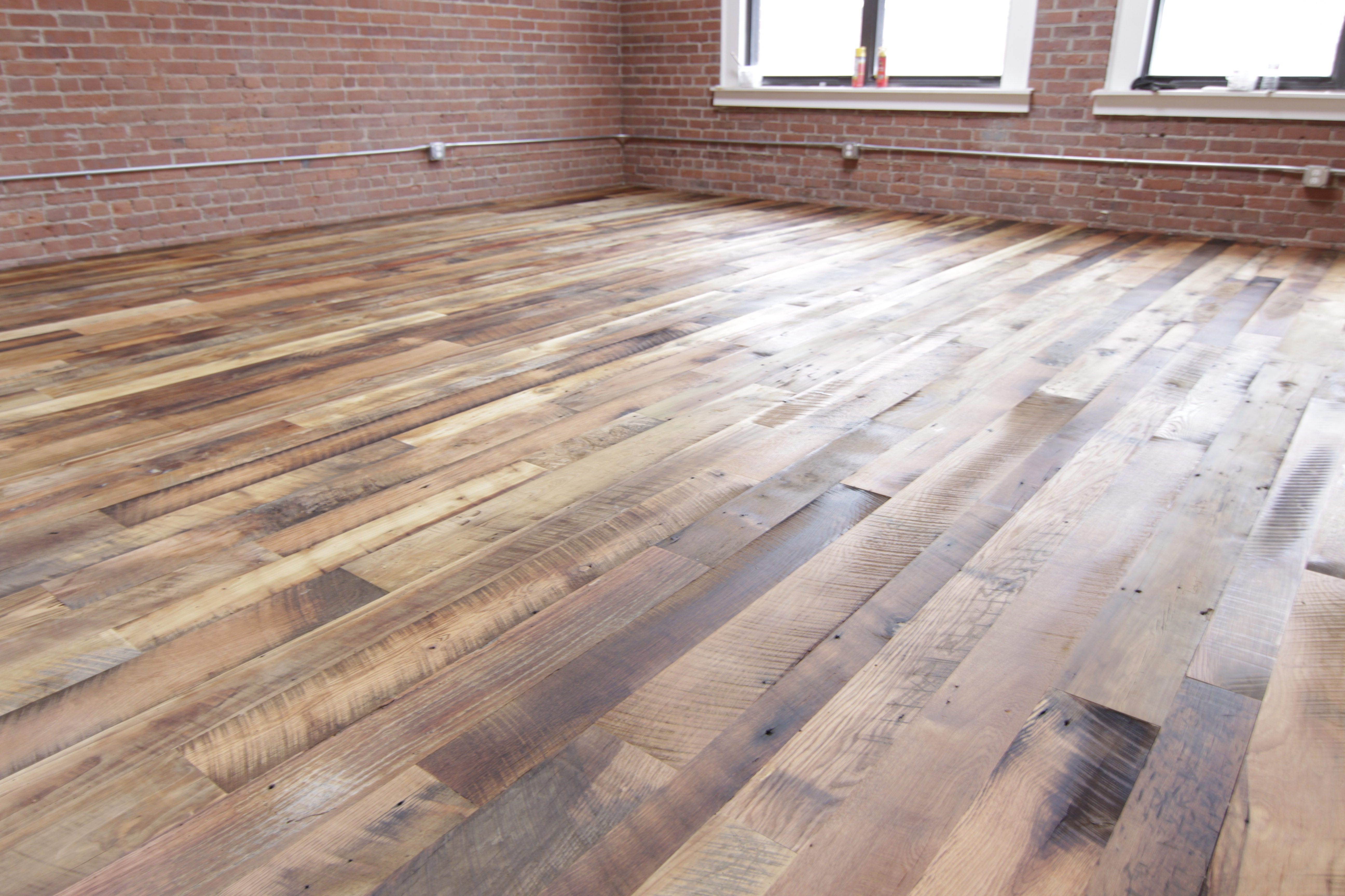 Reclaimed random width mixed specie wood floors poplar beech maple white oak red oak chestnut cherry and mahogany top coated with waterlox system