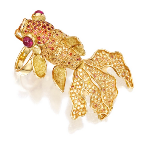 18 Karat Gold, Multi-Colored Sapphire and Ruby 'Lucky Koi' Ring-Pendant, Alexander Laut:  Designed as an articulated koi fish, accented by orange and yellow sapphires weighing approximately 7.80 carats, completed by two cabochon ruby eyes weighing approximately 3.00 carats, gross weight approximately 44 dwts, size 6, signed Laut, numbered 7175; with detachable ring shank and pendant loop for variety of wear.