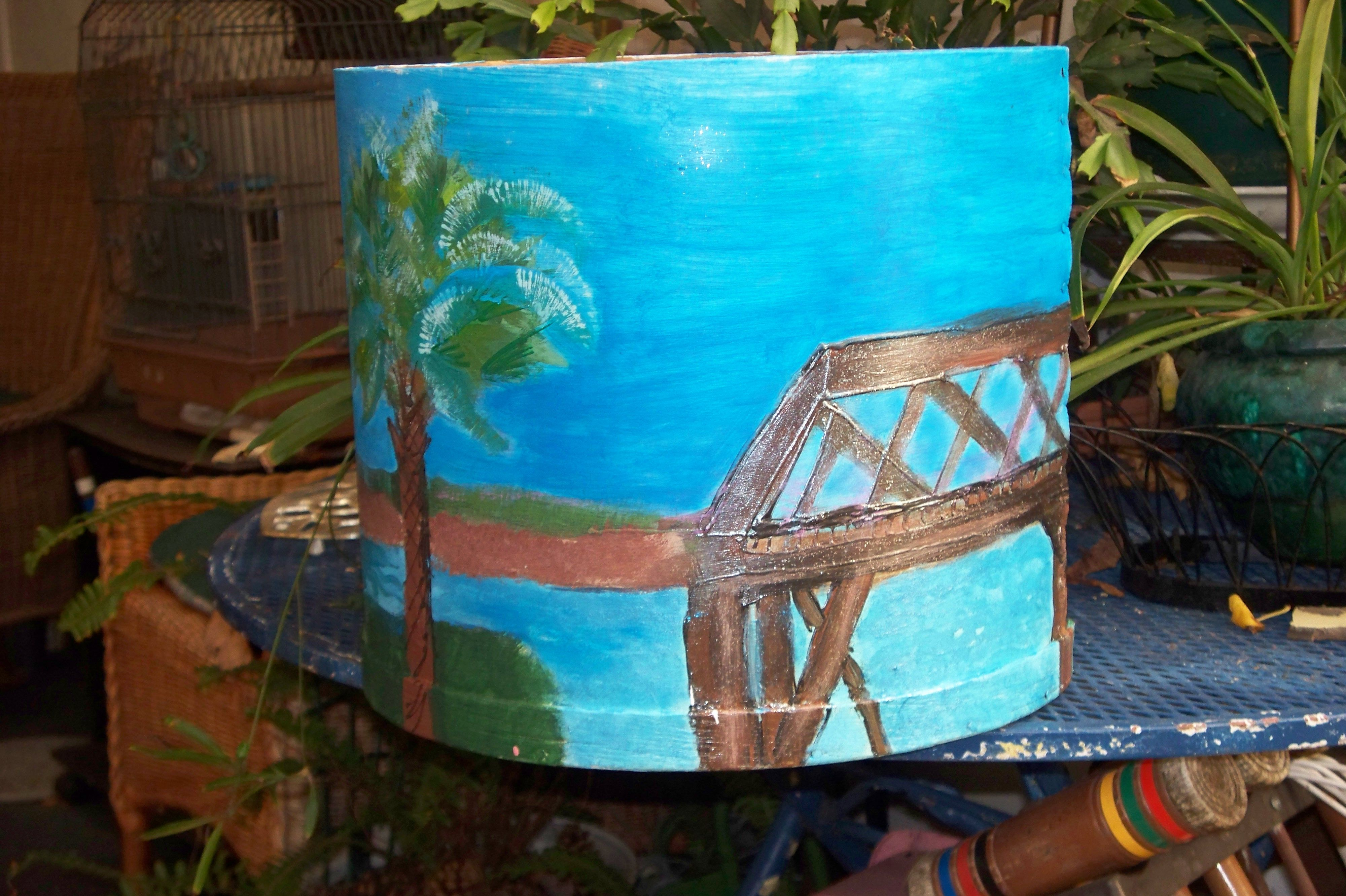 """Side of wooden circular box painted. """"The Sun is Always Shining on Sullivan's"""""""