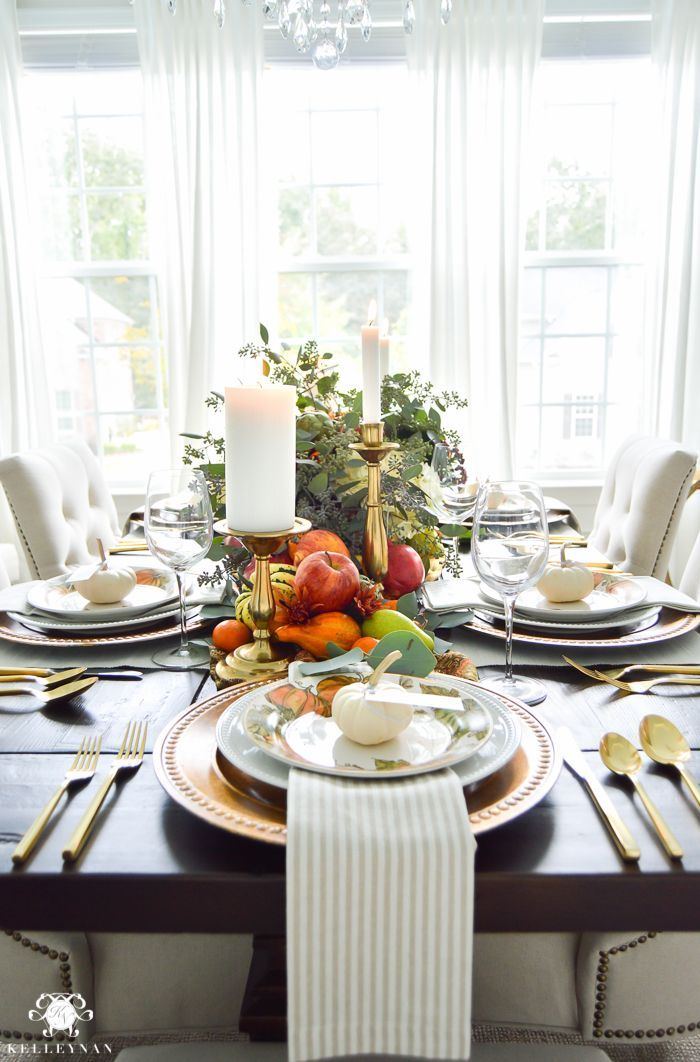 Thanksgiving Dinner Table Ideas - Gold Pottery Barn table setting with fruits, veggies, flowers, and eucalyptus #gedecktertisch