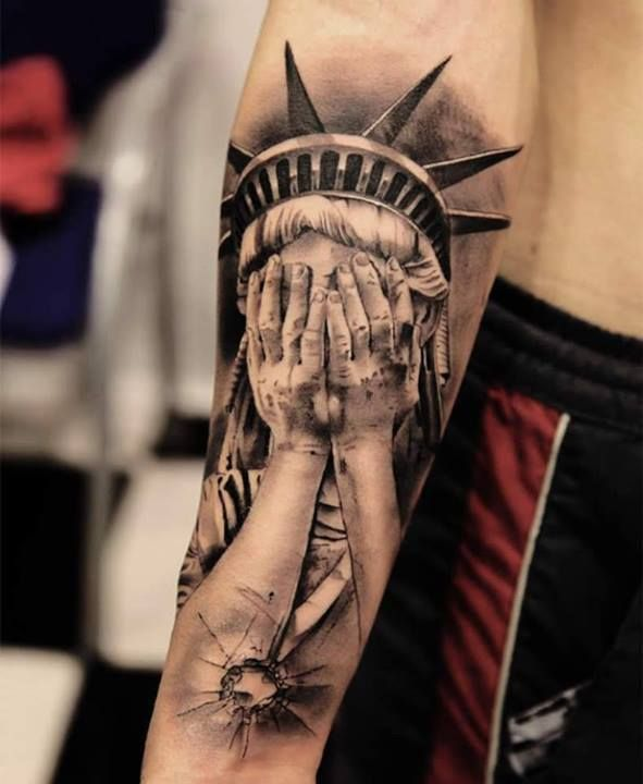 d7a7093106ef8 This is a super meaningful tattoo. Statue of Liberty crying. Watching  America. Love this.