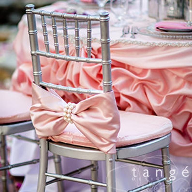 20 platinum bows with large pearl wrap chiavari chair