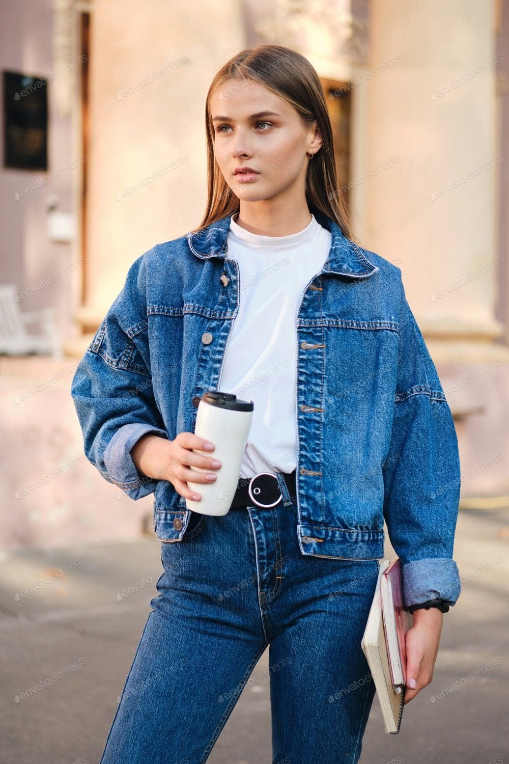Young Serious Stylish Student Girl In Denim Jacket Thoughtfully