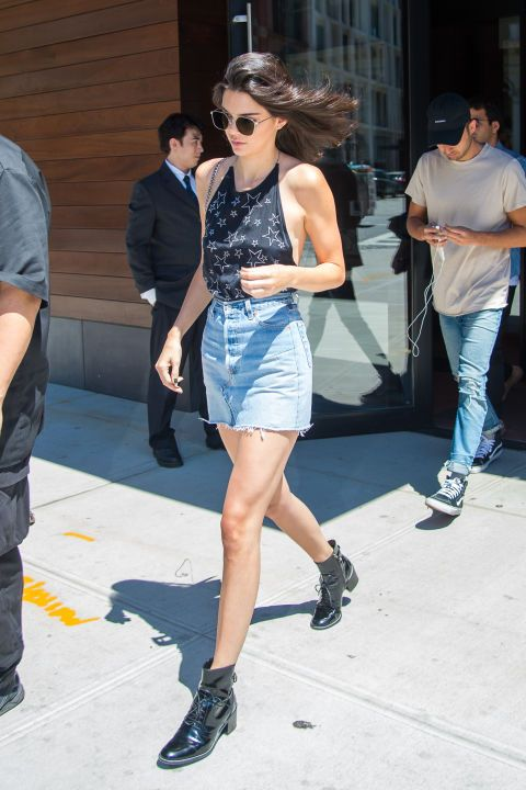6f30da89b Kendall Jenner wearing a star tank-top, a denim mini skirt and Louis  Vuitton boots while out in NYC.