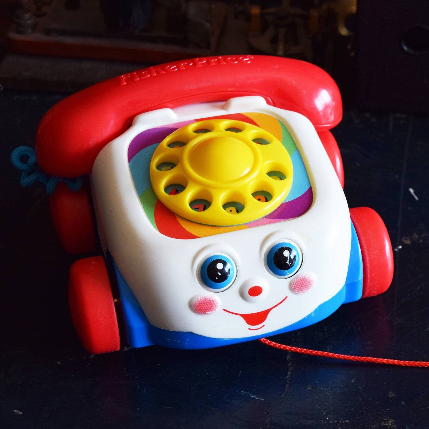 vintage fisher price rotary phone pull toy motor skill development [ 1500 x 1500 Pixel ]