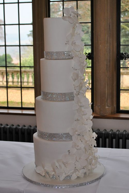 Very Tall Sparkly Diamante Trimmed Wedding Cake With Sugar Orchids Delivered To Coombe Lodge