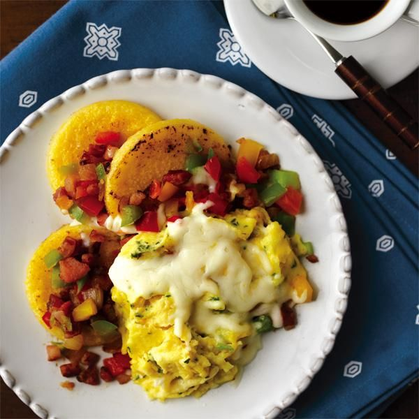 Polenta Eggs, made with a tube of polenta, pancetta, onions, sweet peppers, and cheese.