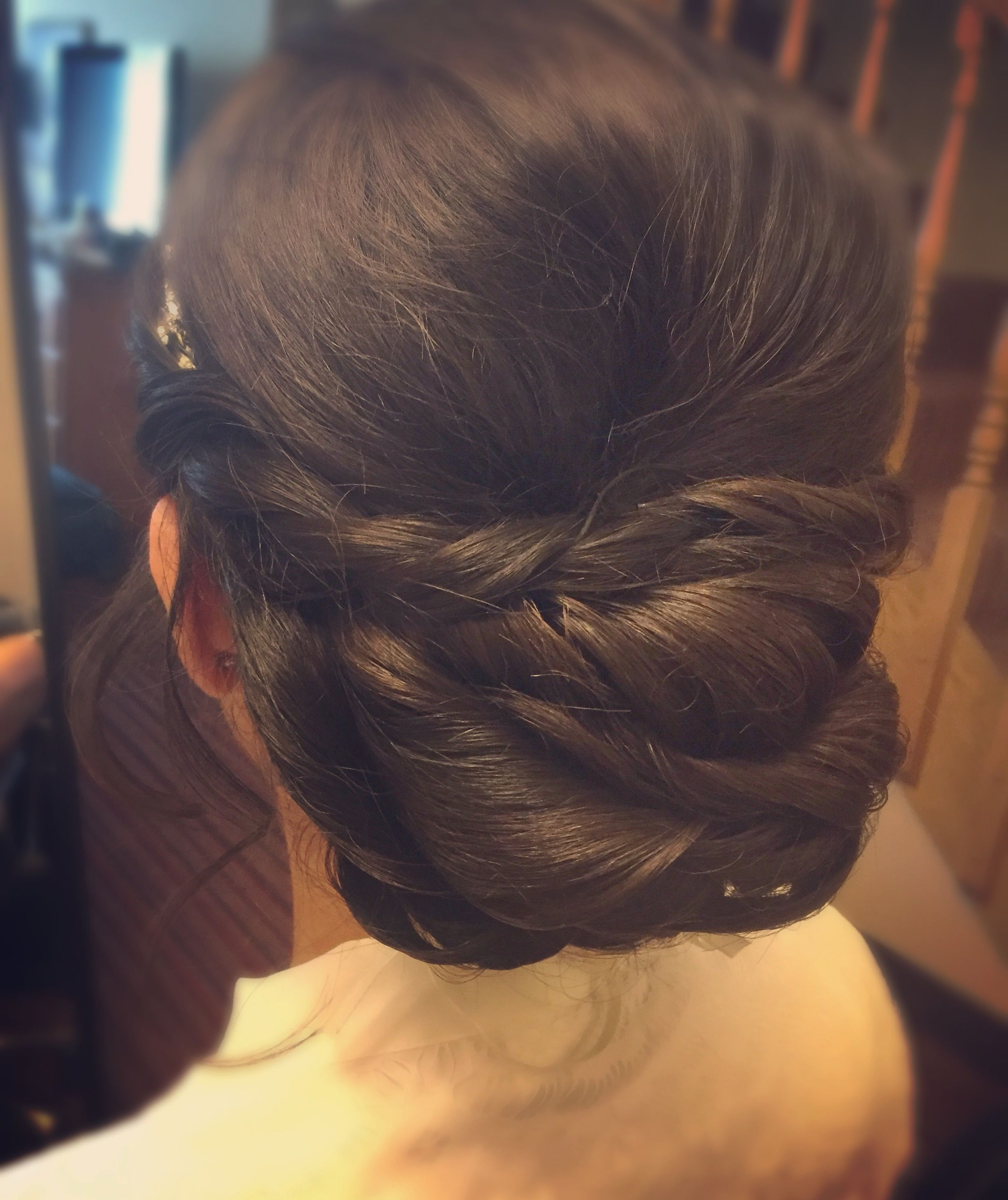 Low twisted updo bridal hairstyle
