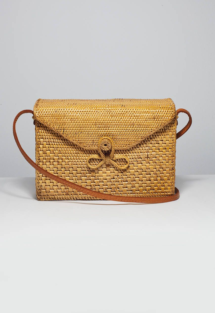 ce7a995ea6 The handbag of summer is certainly woven and these darling styles from Bali  are among my favorite Etsy finds. Ellenn James sells a wide variety of  rattan ...