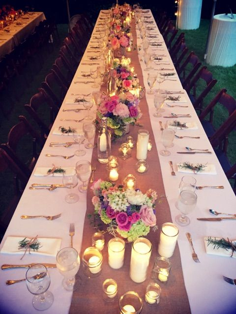 Table setting with rustic decor and rental silverware.