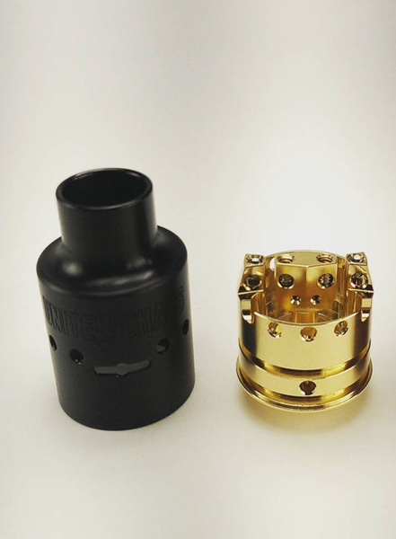 """United Chaos RDA by United Machining  100% Made in USA     100% Gold Plated Positive Post and 510 Connection     .097"""" (2.5mm) Post Holes     Hardcoated Top Cap for ultimate durability     360° Adjustable Airflow         Airflow through Center Post         No airflow ports at bottom of Deck to minimize/eliminate leaking         Efficient Airflow Design reduces noise while vaping  Adjustable 510 Connection     Ultem 1000 Plastic Insert separates positive/ negative charge     Deep Juice Well…"""