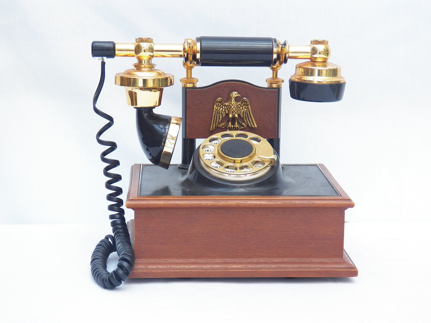 Vintage Deco Tel Rotary Dial Cradle Telephone-WORKING- American Eagle - Wood Brass - Antique Gold Model USA collectible- Fathers Day. $45.99, via Etsy.