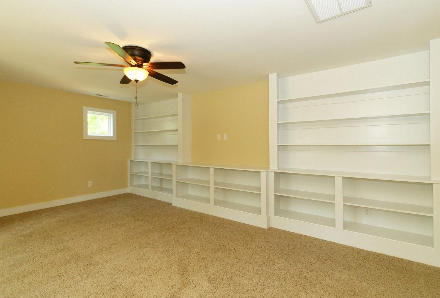 Bonus room with full wall of built ins. The open wall space is ...