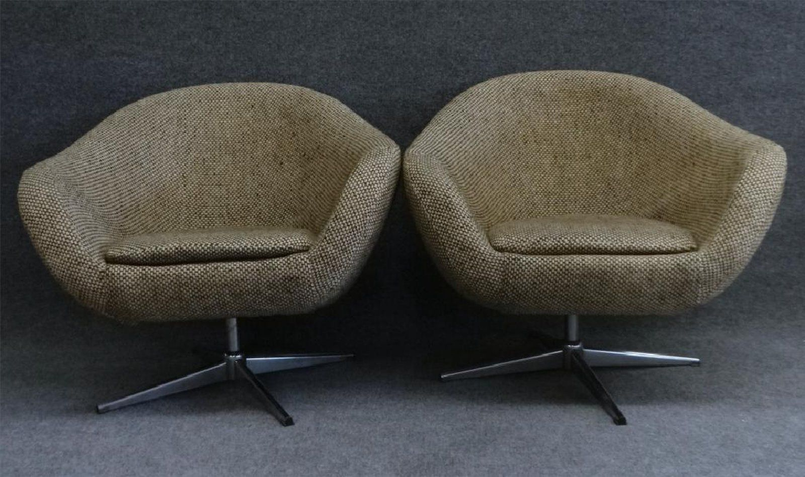 PR OF MID CENTURY UPHOLSTERED SWIVEL BUCKET CHAIRS