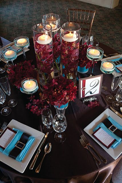 Submerged Burgundy Orchids With Floating Candles Add