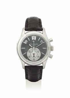 PATEK PHILIPPE. A VERY FINE PLATINUM AUTOMATIC ANNUAL CALENDAR FLYBACK CHRONOGRAPH WRISTWATCH WITH DAY AND NIGHT INDICATION, POWER RESERVE, CERTIFICATE AND BOX
