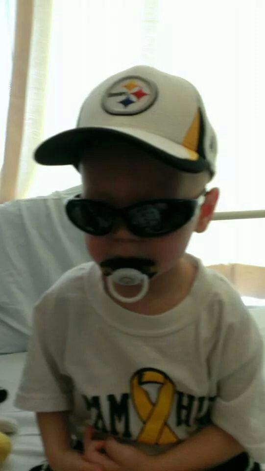 ROCKING HIS STEELER GEAR HOPEFULLY HE WONT REMEMBER MUCH , HE IS SO YOUNG