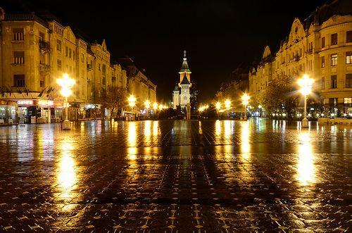 Rainy night view  in Timisoara's main square - Victory square - ROMANIA