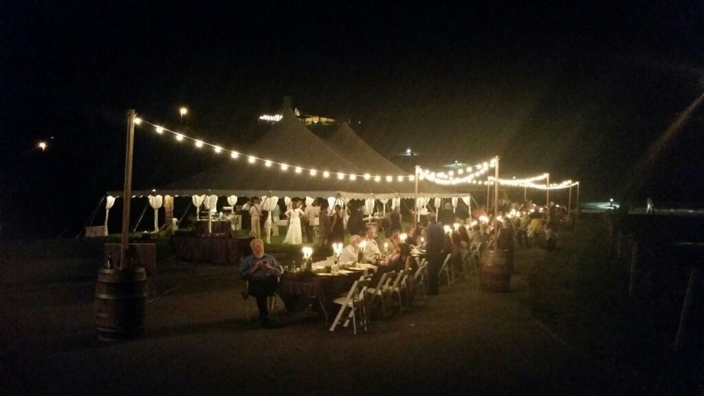 Outdoor cafe lighting draped over a long dinner table lighting outdoor cafe lighting draped over a long dinner table lighting support poles are made mozeypictures Image collections