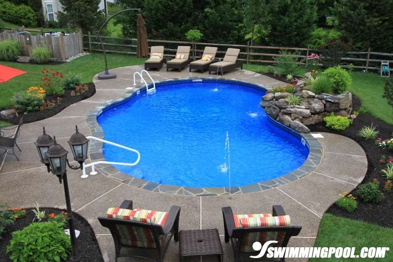 Free Form Vinyl Pool With Stone Coping Swimmingpool Com Inground Pool Landscaping Backyard Pool Landscaping Landscaping Around Pool