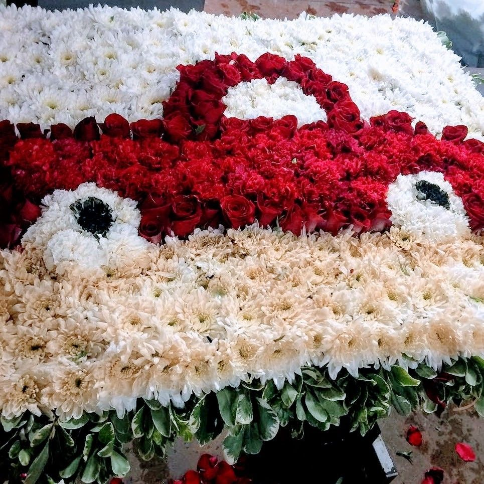 Funeral tribute flowers for a red car lover designed by funeral tribute flowers for a red car lover designed by mireyasflowers in california flower mall izmirmasajfo