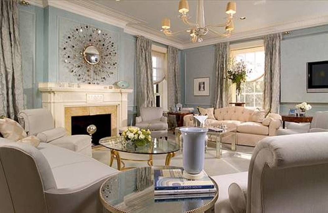 Best Interior Living Room With Sunburst Mirror Over Mantel And Chandelier With Eggshell Blue Wall Co Blue Living Room Grey Walls Living Room Glamourous Bedroom