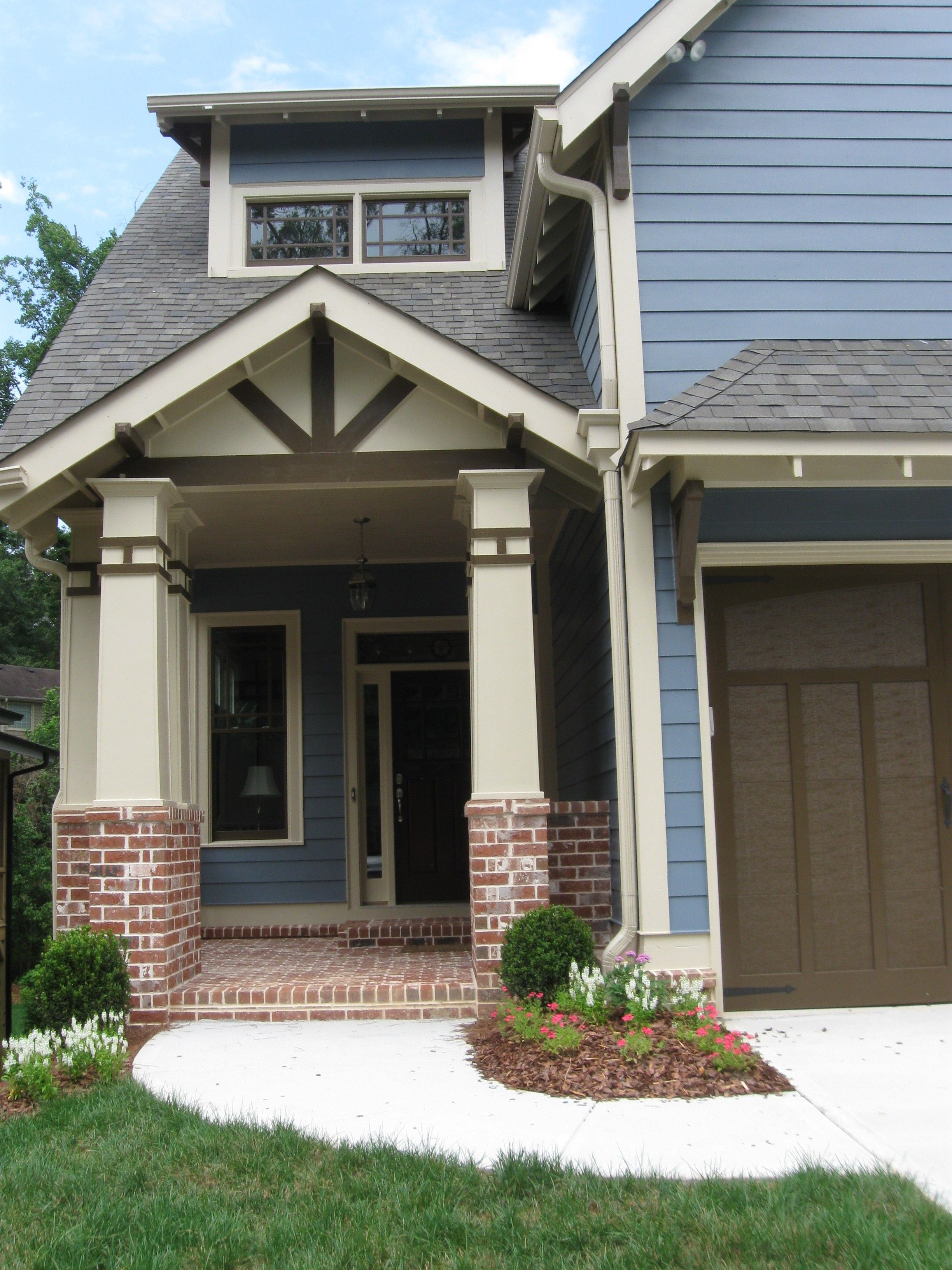 Blue And Cream With Brown Accents House Exterior Blue Exterior Door Colors Beach House Exterior