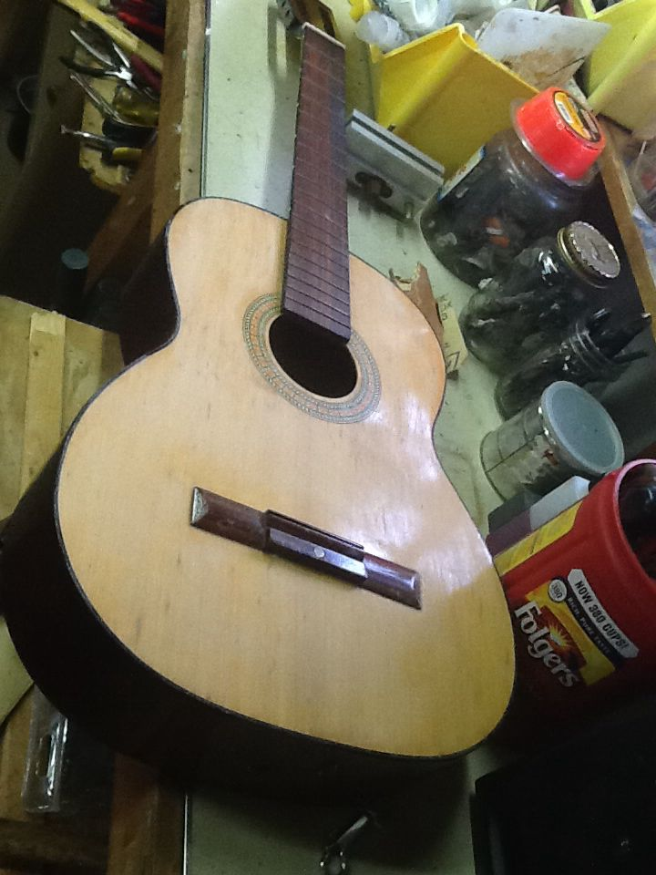The first part of sanding the guitar. Pretty much a before picture here. You can faintly see the thin white layer or dust where I hand sanded.
