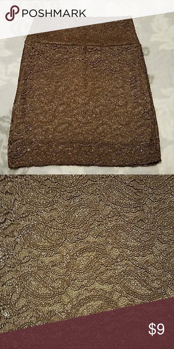 Brown shimmery skirt with lace detail 💥BRAND NEW💥  🌹Size- M 🌹Color- Brown/Bronze (Shimmery)  ✏Bronze colored skirt with lace detail and shimmer. Length is about 5 fingers above the knee. Elastic waistband, stretchy.  🎀Looks cute with heels, perfect for a night out with the girls.   💲OPEN TO OFFERS💲  📫Will ship the very next day📫 ⚠When on vacation will label everything NOT FOR SALE until I return⚠  🎁HAPPY POSHING🎁 Skirts Midi
