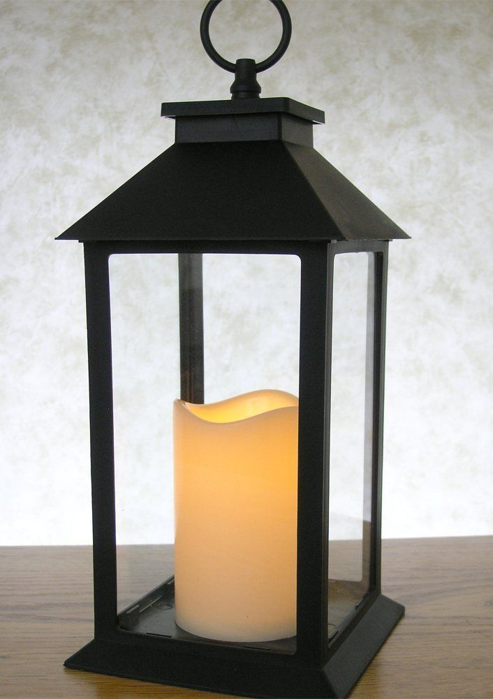 INDOOR/OUTDOOR LANTERN. Beautiful black powder coated lantern with led flameless candle and timer function included. On/off switch for simple control. Warm whit