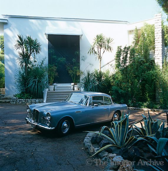 A 1960 Graber Alvis Car Stands In The Driveway Of The