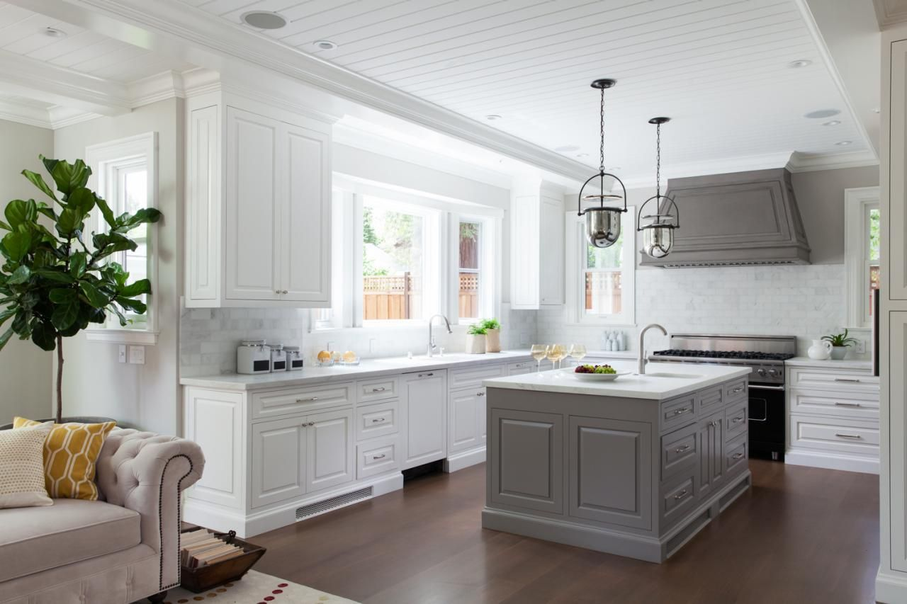 This transitional kitchen features carrara marble countertops