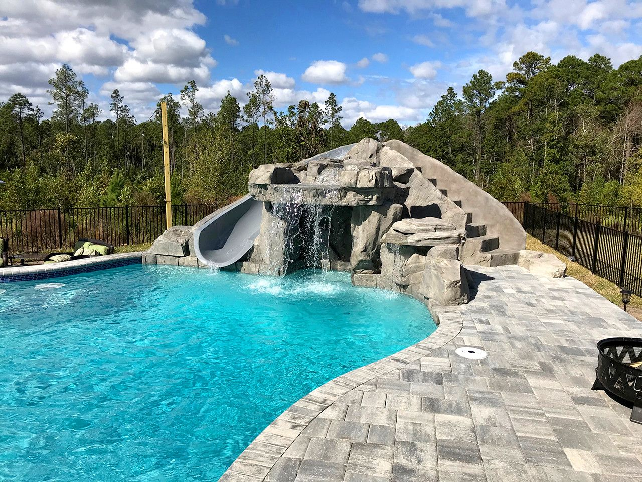 This Gorgeous Florida Pool Features A Ricorock Faux Rock Grotto Waterfall And Miscellaneous Bou Pool Waterfall Swimming Pool Waterfall Swimming Pool Pictures