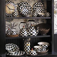 Classic Mackenzie-Childs Courtly Check. i have always loved this black & white motif with the little red knobs.