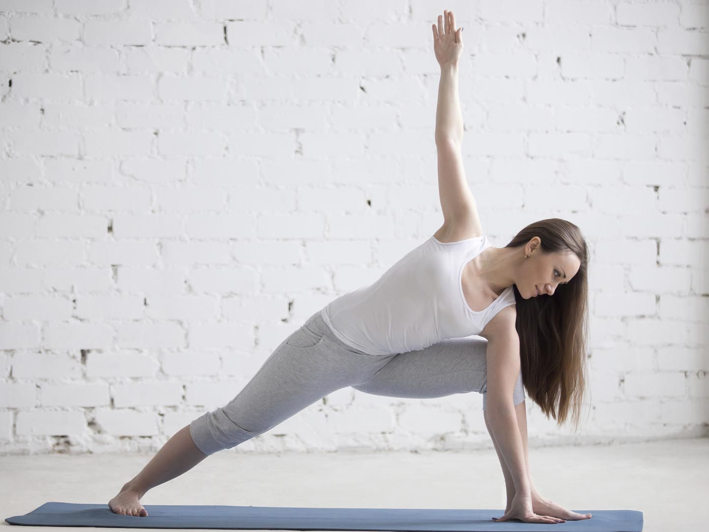 A Relatively Advanced Yoga Pose The Extended Side Angle Offers An Invigorating Combination Of