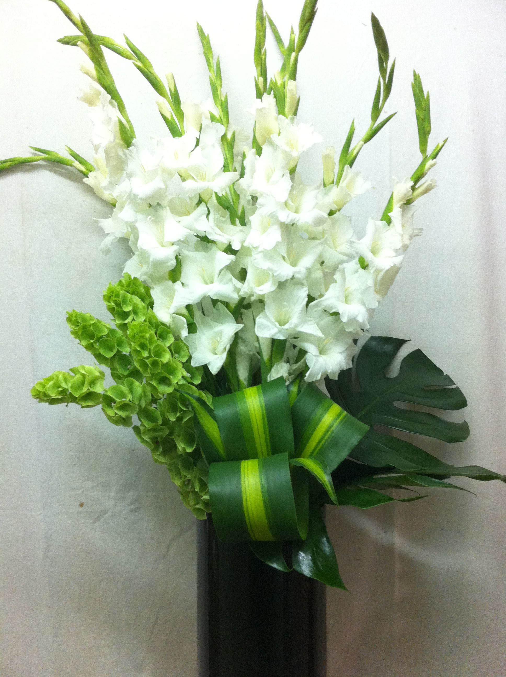 This Beautiful Arrangement By Belflora Combines White Gladioli, Malacacca Balm,