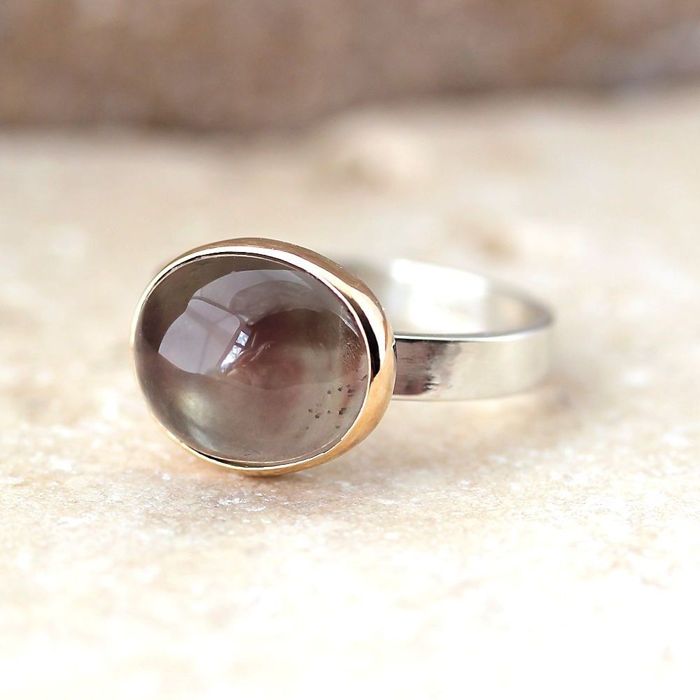 Oregon Sunstone Ring, Peach Pink Sage Green Stone 14k Gold Ring and Sterling Silver Ring Sunstone Jewelry - US Size 6 - Firefly. $135.00, via Etsy.