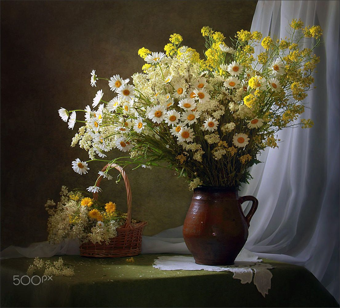 With a bouquet of meadow flowers by