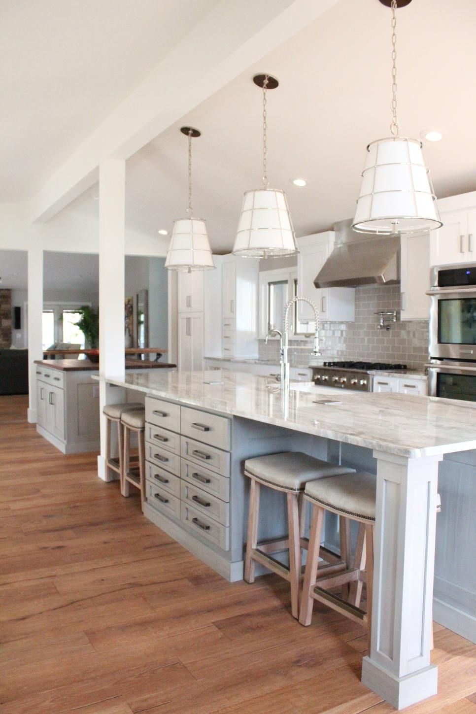 Perfect Marble Countertops And Chrome Pendant Lights Add Sophistication To This  Gray, Open Kitchen. Two