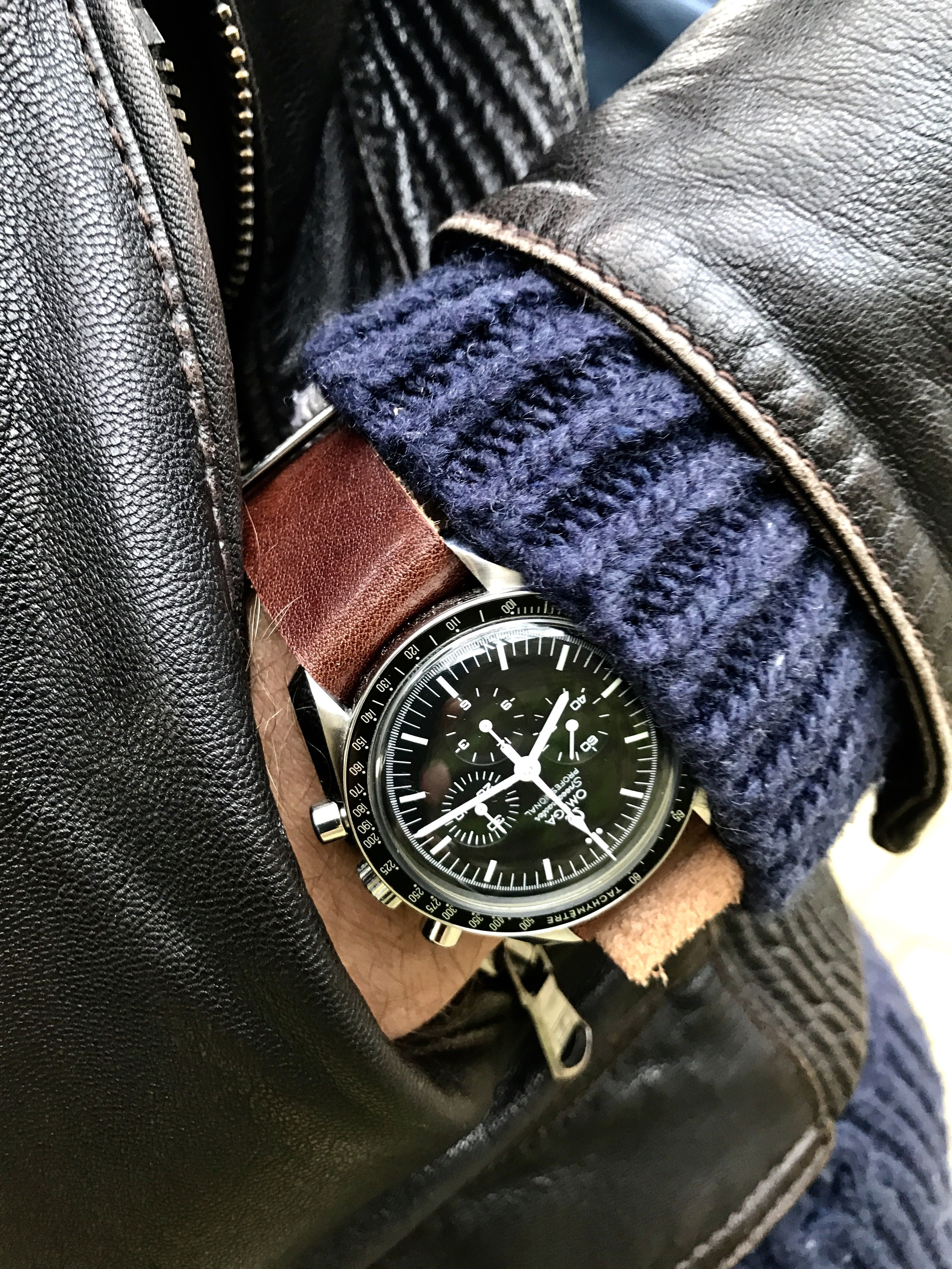 fde7ed90490 Vintage leather jacket with a vintage leather nato strap on the Omega  Speedmaster Professional luxury and legendary watch.
